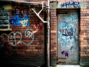 Derelict Door with Graffiti 2 by Clive Nolan