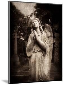 Statue of a Female Angel Praying in Cemetery by Clive Nolan