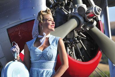 Close-Up of a 1940's Style Pin-Up Girl in Front of a Vintage F3F Biplane--Photographic Print