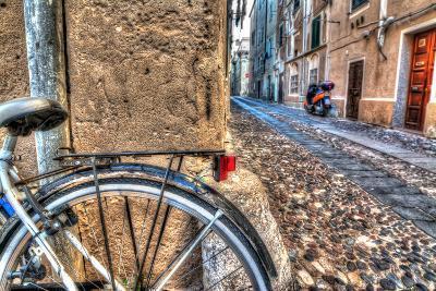 Close up of a Bike Wheel in Alghero Old Town-Gabriele Maltinti-Photographic Print