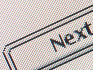 Close-up of a Computer Screen with an Icon and Black Lettering