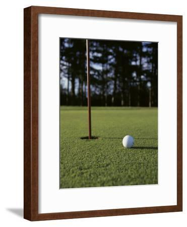 Close-up of a Golf Ball Near the Hole
