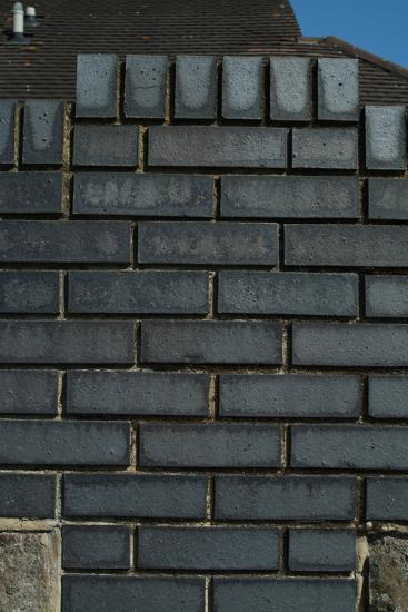 Close Up of a Grey Engineering Brick Wall-Natalie Tepper-Photo