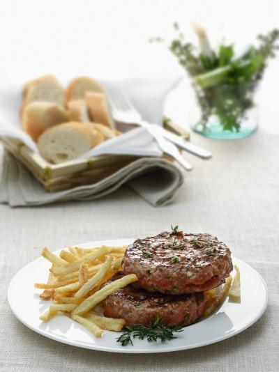 Close-Up of a Hamburger with Herbs and French Fries--Photographic Print