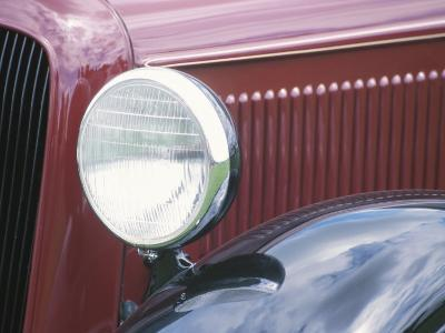 Close-Up of a Headlight on an Antique Vintage Red Car--Photographic Print