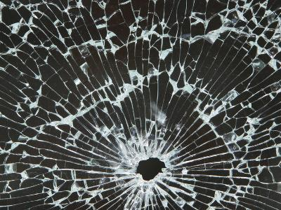 Close-up of a Hole in Cracked and Shattered Glass--Photographic Print