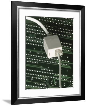 Close-Up of a Plastic Telephone Jack Network Connection Plug on a Circuit Board--Framed Photographic Print