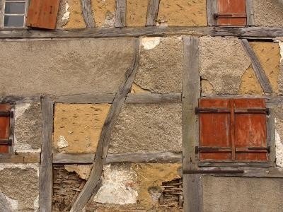 Close-up of a Rustic Stone House with Wood Beams and Small Windows--Photographic Print