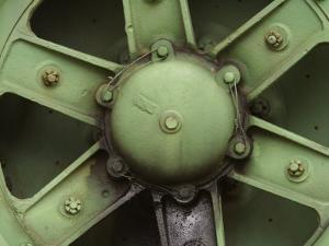 Close-Up of a Rusty Green Steel Wheel