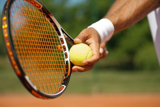 Close up of a Tennis Player Standing Ready for a Serve ...
