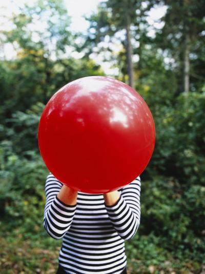 Close-up of a Woman Blowing a Balloon, Germany--Photographic Print