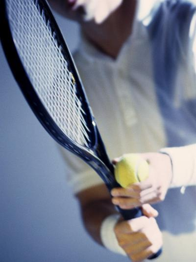 Close-up of a Young Man Holding a Tennis Racket and a Tennis Ball--Photographic Print