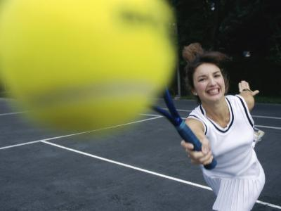 Close-up of a Young Woman Playing Tennis--Photographic Print