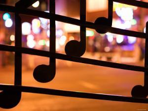 Close Up of Artistic Wrought Iron Musical Notes at Night