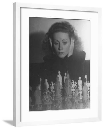 Close Up of Danielle Darrieux Looking at Chess Pieces-David Scherman-Framed Premium Photographic Print