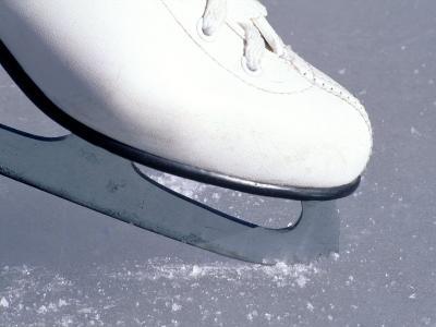 Close-up of Figure Skate on Ice-Ken Wardius-Photographic Print