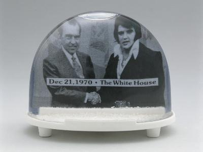 Close-Up of Figurines of Elvis Presley and Richard Nixon with Handshake in a Snow Globe--Photographic Print
