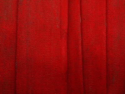 Close-up of Flat Red Fire Hoses--Photographic Print