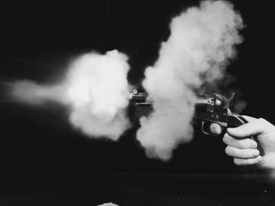 Close-Up of Gun Being Fired--Photographic Print