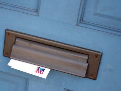 Bon Close Up Of Mail Slot On Door With Letters Sticking Out In New Orleans,  Louisiana