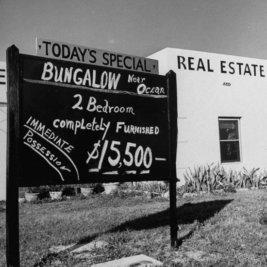 Close-Up of Real Estate Sign-Ed Clark-Photographic Print