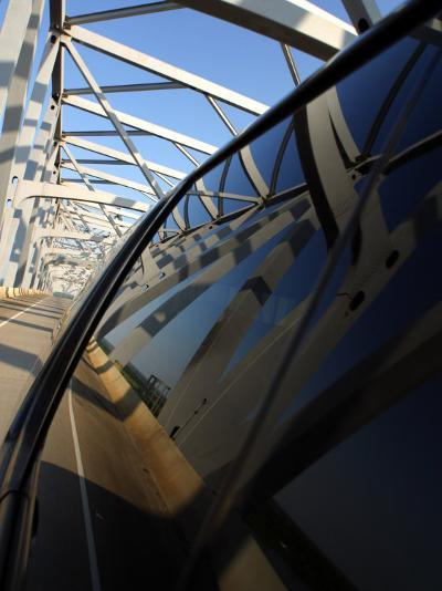 Close-Up of Reflection of Bridge on Smooth Car Window--Photographic Print