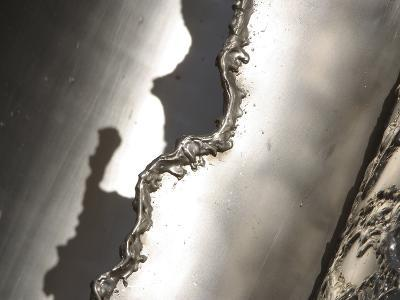 Close-up of Rough Texture Engraved on a Shiny Metallic Surface--Photographic Print