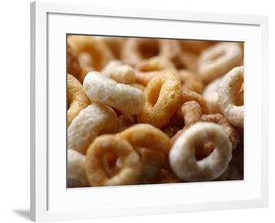 Close-up of Round Frosted Breakfast Cereal--Framed Photographic Print