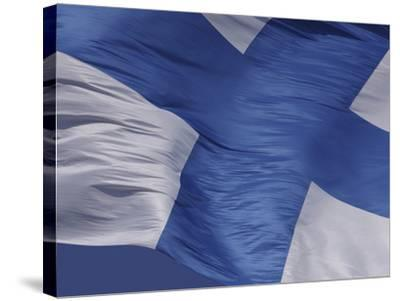 Close-up of the Flag of Finland on White Fabric with a Blue Cross