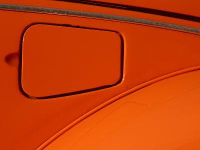 Close-up of the Gas Tank Lid on an Orange Car--Photographic Print