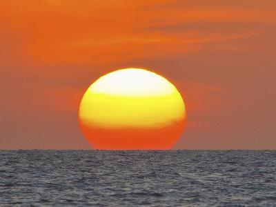 Close Up of the Sun Setting over the Gulf of Mexico-Mike Theiss-Photographic Print