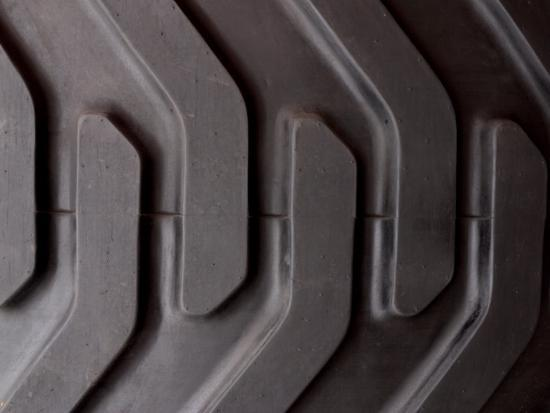 Close-Up of Treads and Grooves of an Industrial Tire--Photographic Print