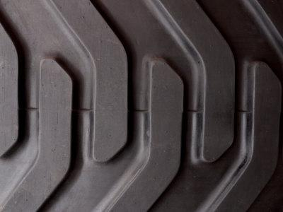 https://imgc.artprintimages.com/img/print/close-up-of-treads-and-grooves-of-an-industrial-tire_u-l-q10x8ev0.jpg?p=0
