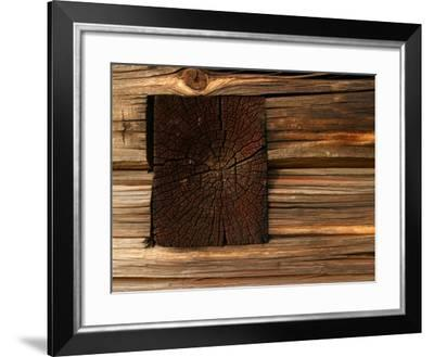 Close-Up of Weathered and Rustic Log Cabin--Framed Photographic Print
