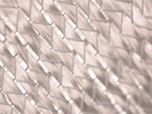 Close-Up of Woven Glass Fibers with a Silvery Metallic Sheen