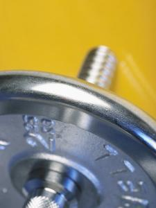 Close-Up Studio Shot of a Steel Weightlifting Dumbbell