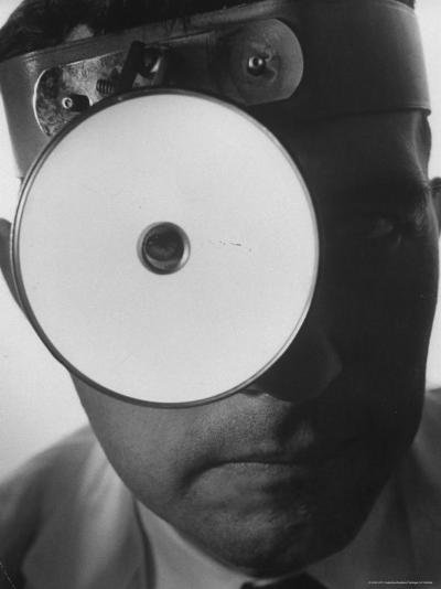 Closeup of a Doctor Wearing a Mask of His Profession-Andreas Feininger-Photographic Print
