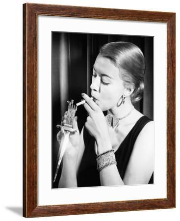 Closeup of Woman Lighting Cigarette--Framed Photo