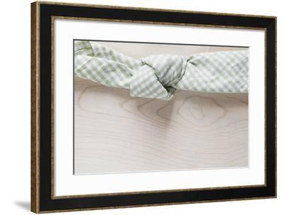 Cloth Napkin with Node on Wood-Petra Daisenberger-Framed Photographic Print