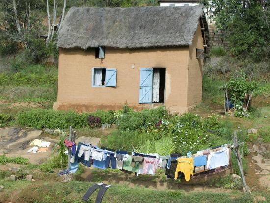 Clothes Drying on a Clothesline in Front of a House, Madagascar--Photographic Print
