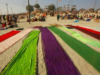 Clothes of Hindu Devotee are Laid out to Dry after Being Drenched During Ritualistic Holy Dips-Aman Sharma-Photographic Print