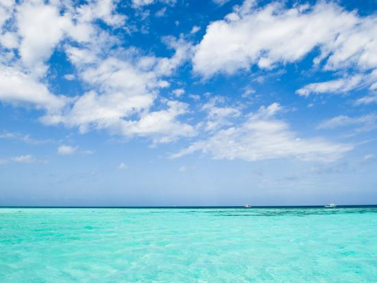 Cloud-Filled Sky and Clear Blue Waters of Ambergris Cay-James Forte-Photographic Print