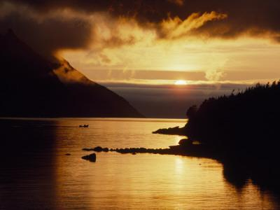Cloud-Filtered Sunset Silhouettes a Boat on the Sheltered Waters of Bonne Bay-Raymond Gehman-Photographic Print