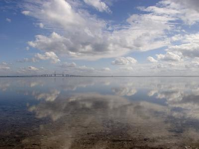 Cloud Reflections in Calm Water with the Sunshine Skyway Bridge-Skip Brown-Photographic Print