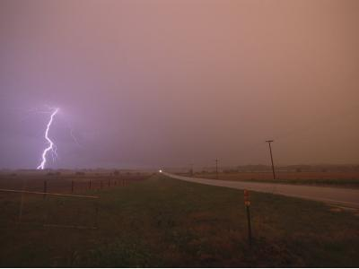 Cloud-To-Ground Lightning Strikes a Field and Brightens a Foggy Sky-Peter Carsten-Photographic Print