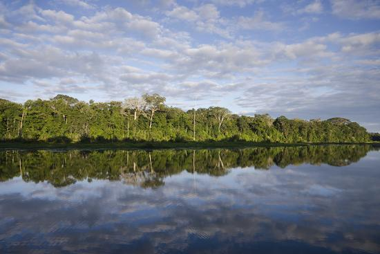 Clouds and Forested Coastline Reflected in Calm Water-Bertie Gregory-Photographic Print
