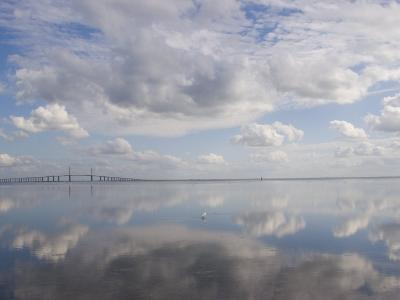 Clouds and Sky are Reflected in Calm Water with Bridge-Skip Brown-Photographic Print