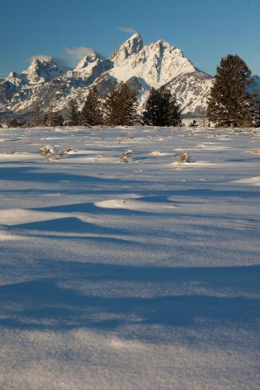 Clouds Drift In The Teton Mountain Range In Front Of Fresh Snow Just After A Winter Sunrise-Greg Winston-Photographic Print