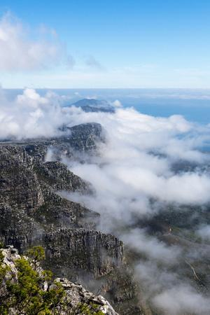 Clouds Fill the Valleys and Gorges of a Coastal Mountain Range Overlooking the Ocean-Jason Edwards-Photographic Print