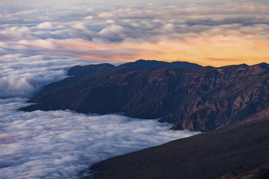 Clouds Obscure Coastal Villages Below Dark Volcanic Mountains of Tenerife's North East Coast-Garry Ridsdale-Photographic Print